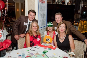 Guests enjoy monopoly with friends and family.